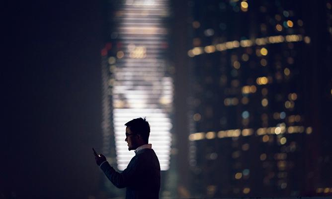 Worker looks over skyline